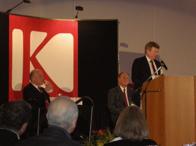 Dave Holley (KHS67, Tom's brother & KHS principal) & Doug Vaughn listen as Jim Olson makes his acceptance speech.